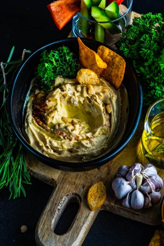 hummus with veggies and chips