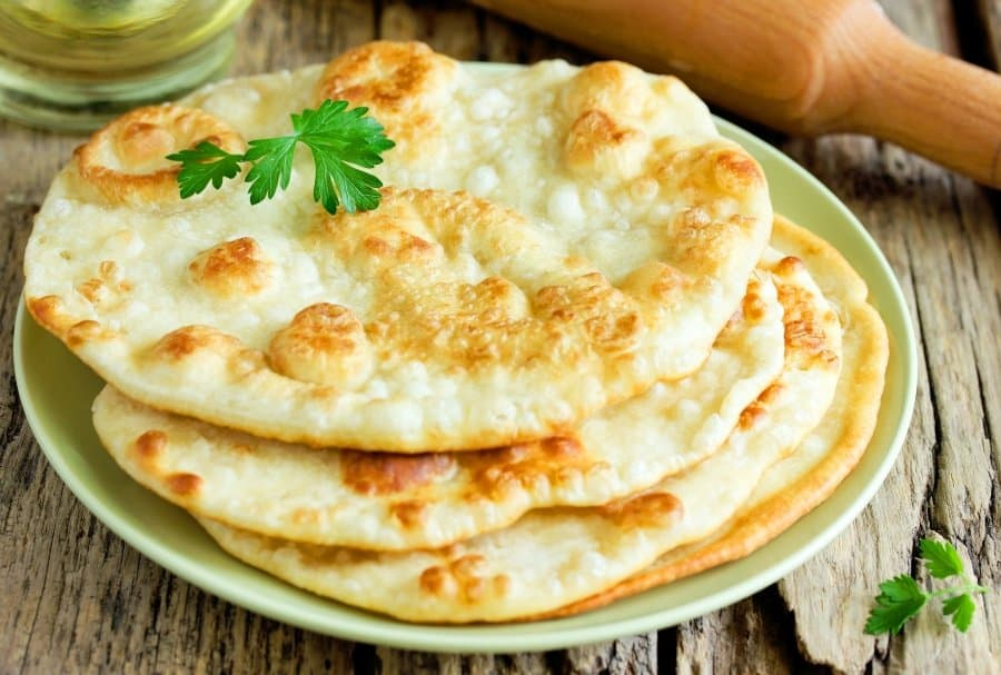 naan on plate with garnish