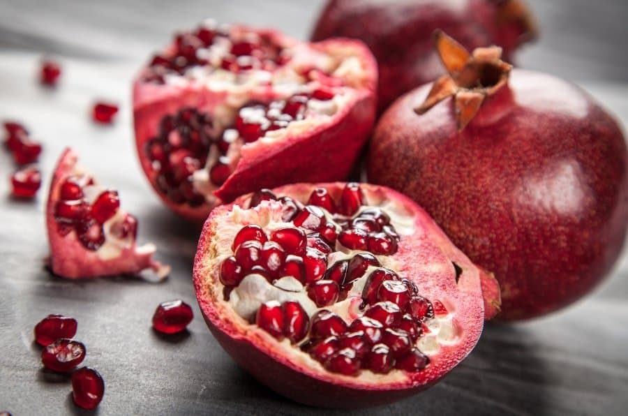 pomegranate cut with seeds exposed
